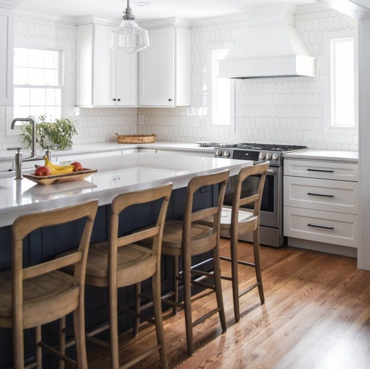 white kitchen with navy island cover