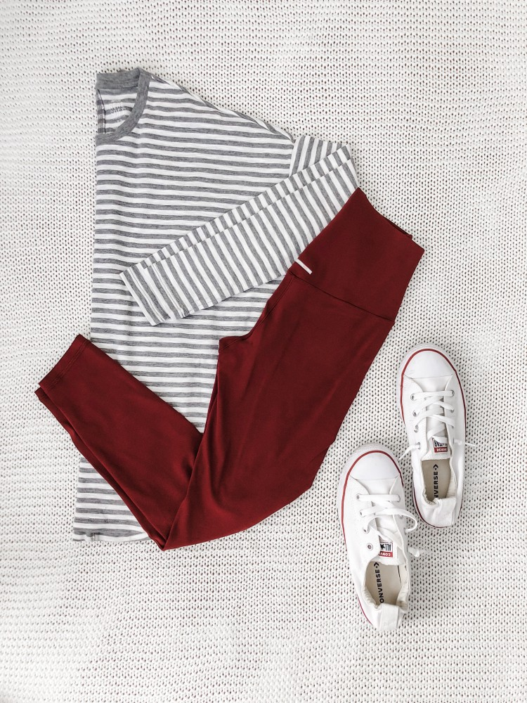 cute leggings outfit for moms - burgundy leggings, grey striped tee, and converse shoreline sneakers #momstyle