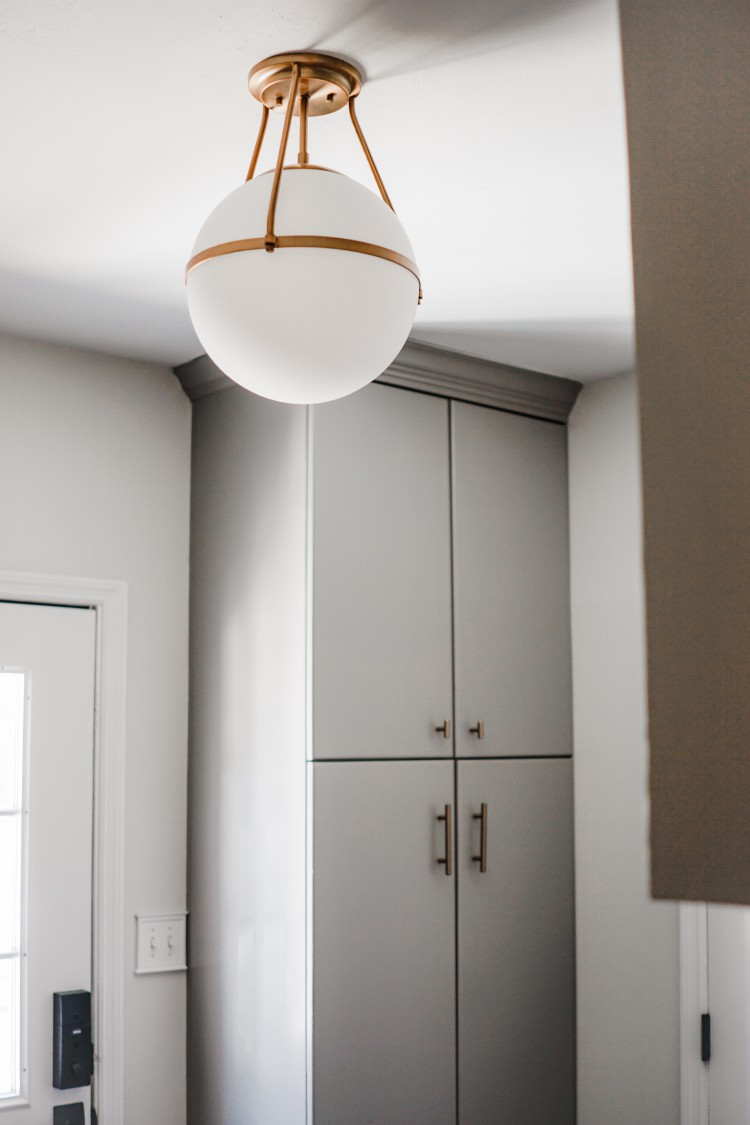 art deco circle semi-flush mount light - love the touch of gold this light brings to the mudroom