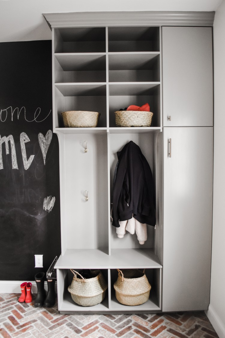 love the mix of open cubbies with multiple hooks alongside closed cabinets for more storage in this mudroom
