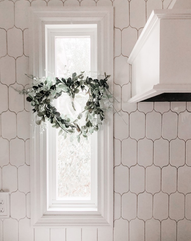 gorgeous faux greenery heart wreath! easy and non-traditional way to decorate for Valentine's Day