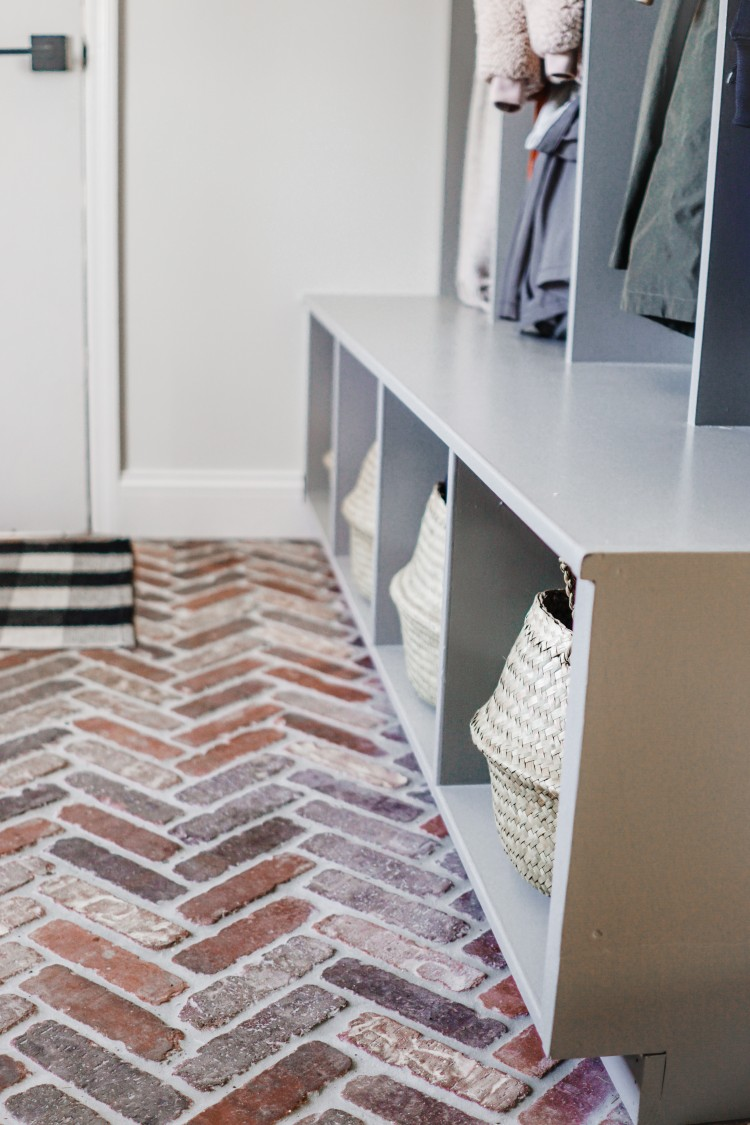 100% love the herringbone brick tile floor for a mudroom