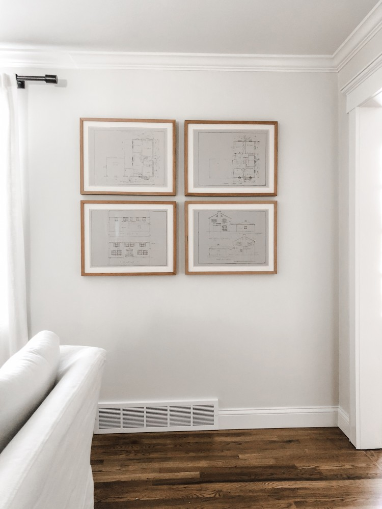 how to hang multiple pictures evenly - and easily! this step by step tutorial shows you how to hang a group of pictures easily