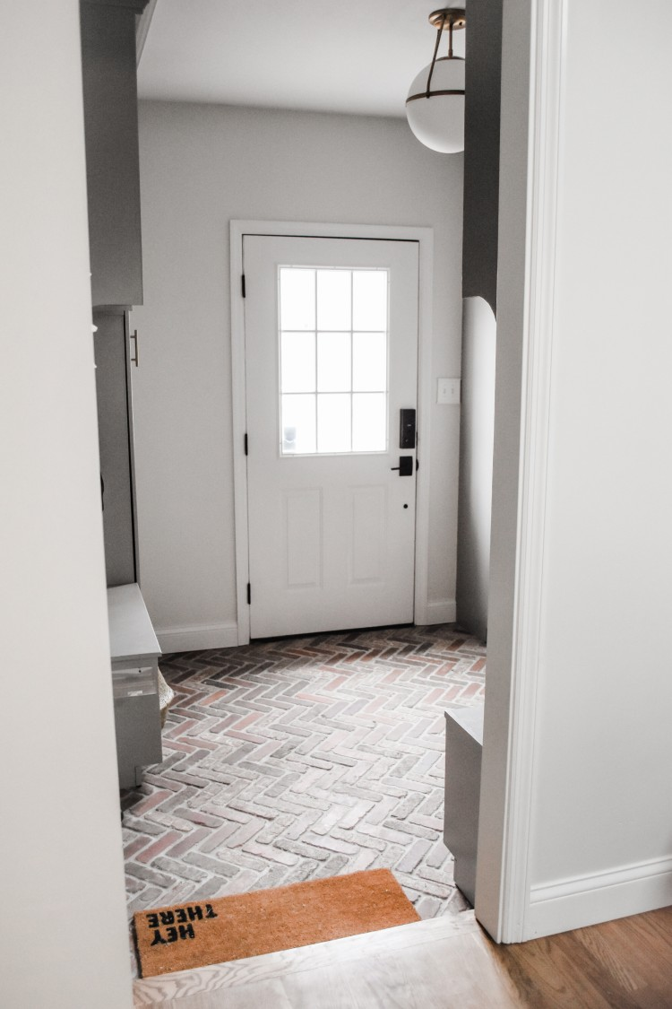 modern classic grey mudroom with a brick floor - LOVE this design!