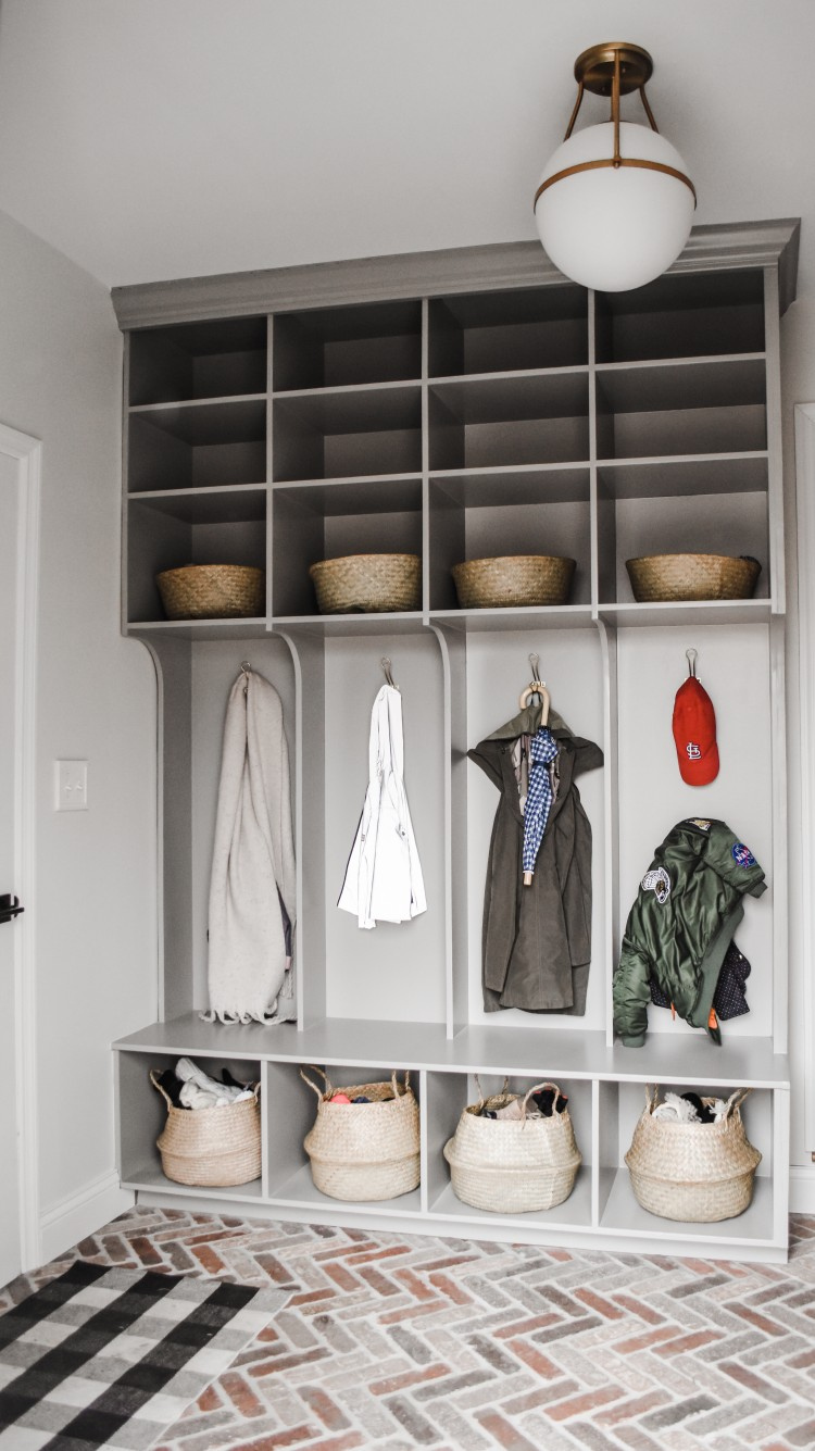 family cubbies in the mudroom for coats, backpacks, and shoe storage