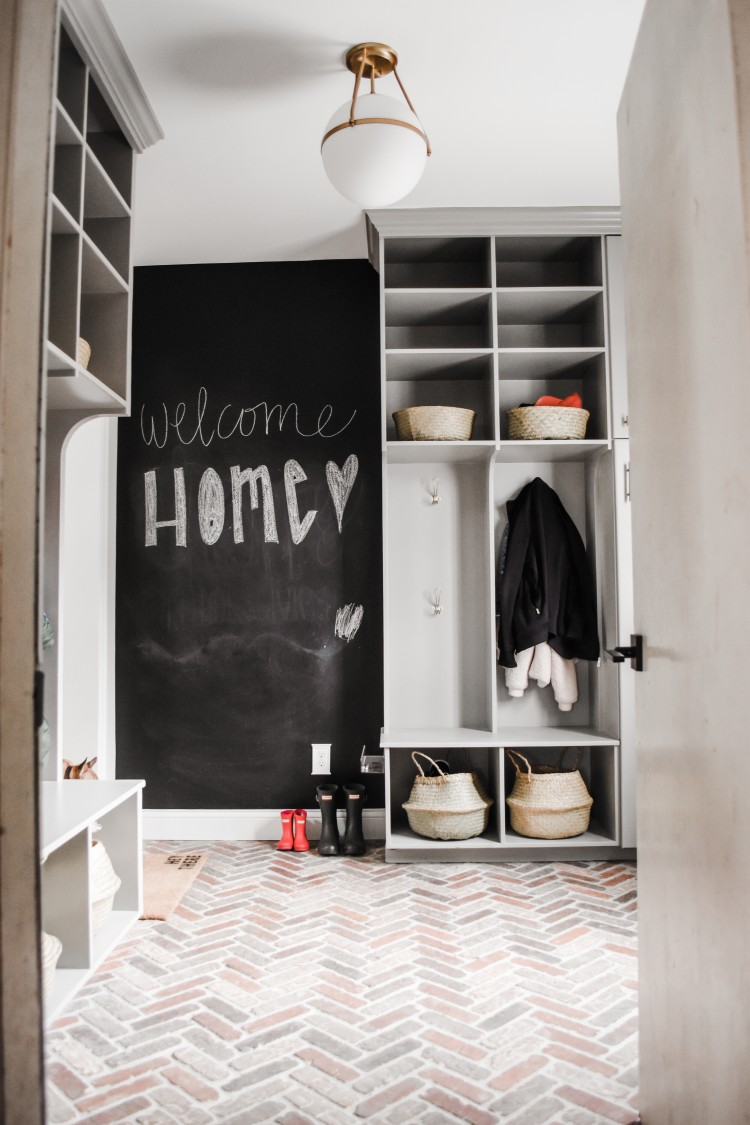 love this mudroom design from a real family with 3 kids! entry from garage into mudroom and house