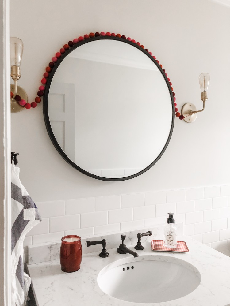 Valentine's day decor ideas for the bathroom - love the subtle pops of red in this classic bathroom