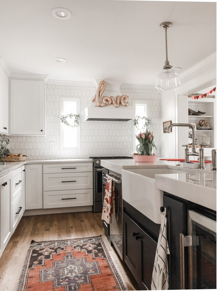script LOVE rose gold balloon on the range hood - love this idea for Valentine's Day decor
