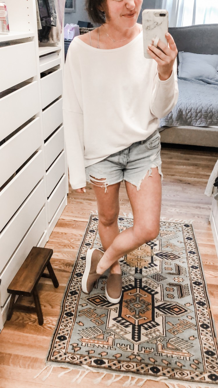 love this casual outfit for spring - cutoff denim shorts, an oversized white top (under $20!) and platform slip ons