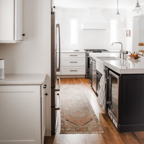 white kitchen with white farmhouse sink