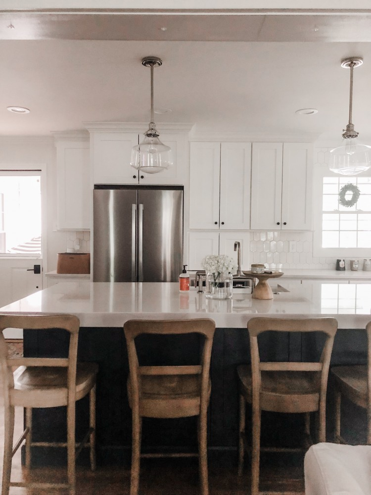 Love the classic pendants.  Beautiful white kitchen.