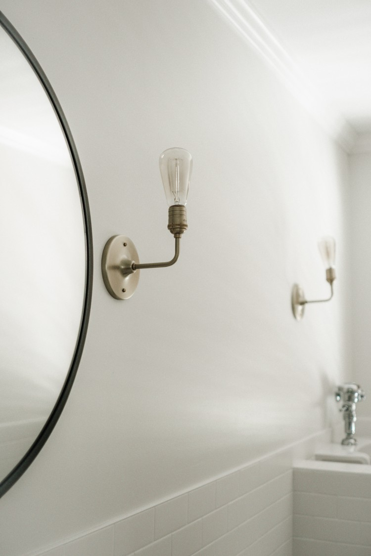 mixed metals 101: we mixed gold (sconces), chrome (urinal flusher) and oil rubbed bronze (mirror + faucet)