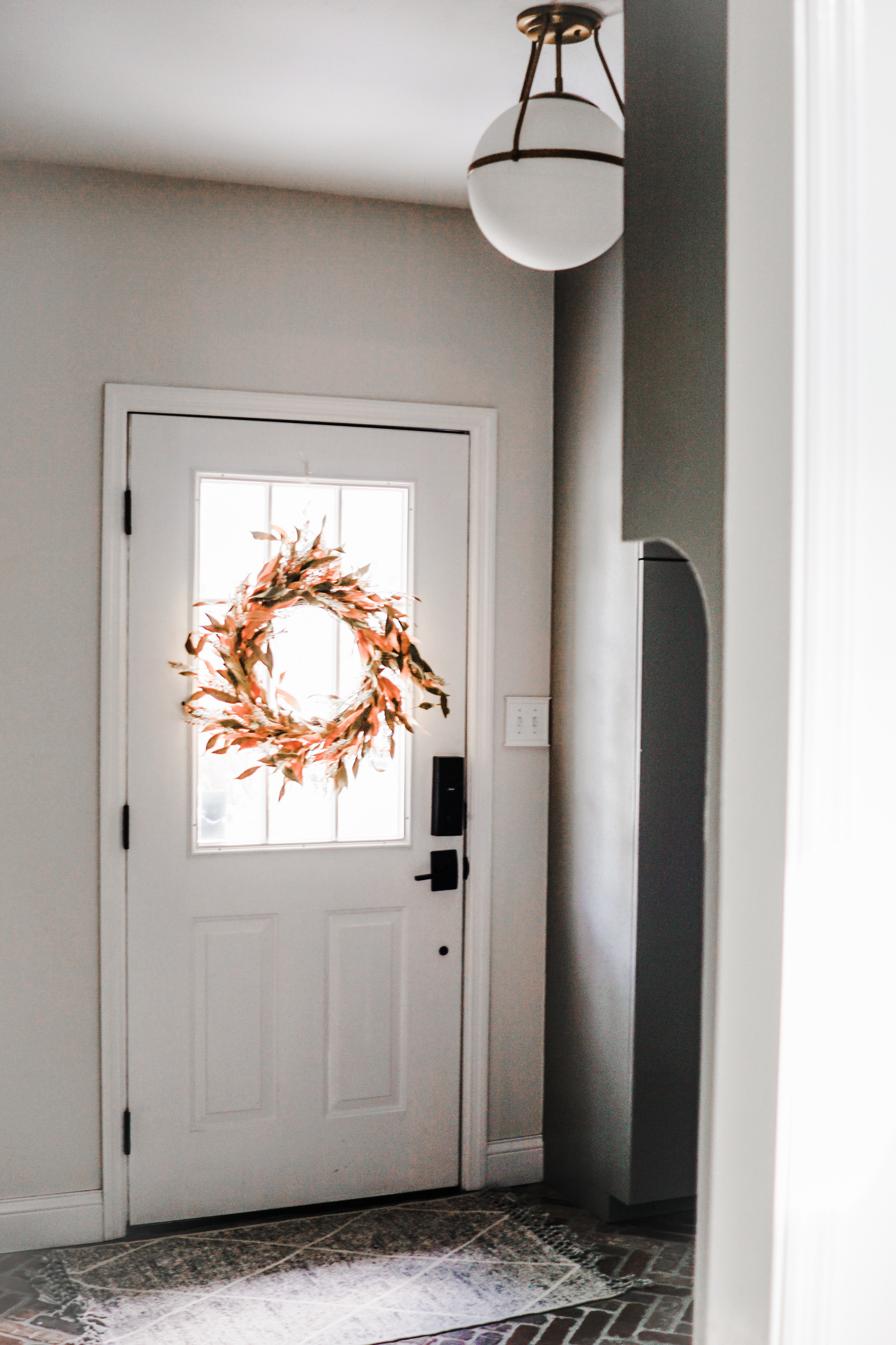 fall decor inspiration - love the pop of color with an orange and gold wreath for a mudroom // fall mudroom decor idea