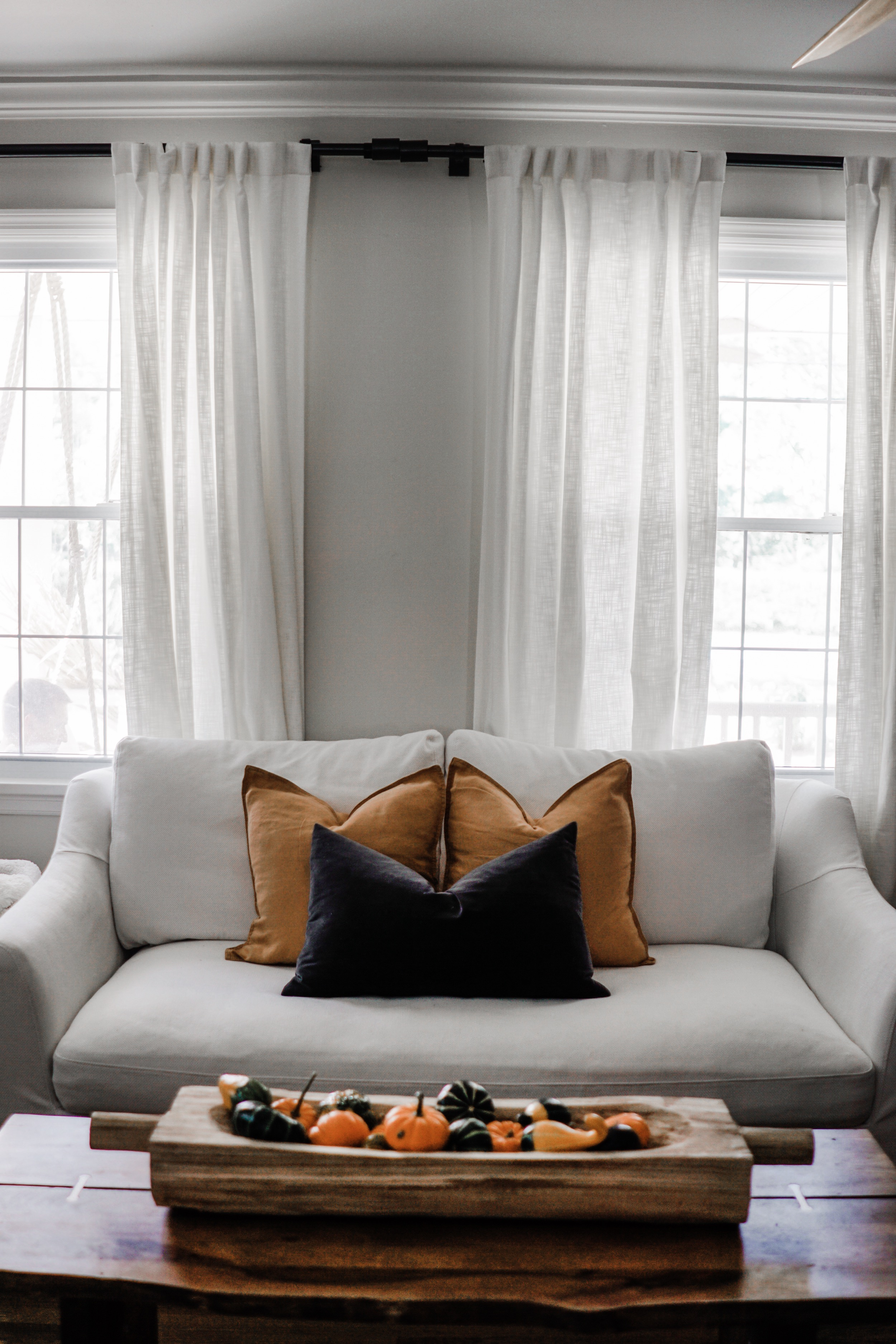 fall decor inspiration - living room with yellow and grey linen pillows.  Pumpkins and gourds for a fall centerpiece.  // fall living room decor idea