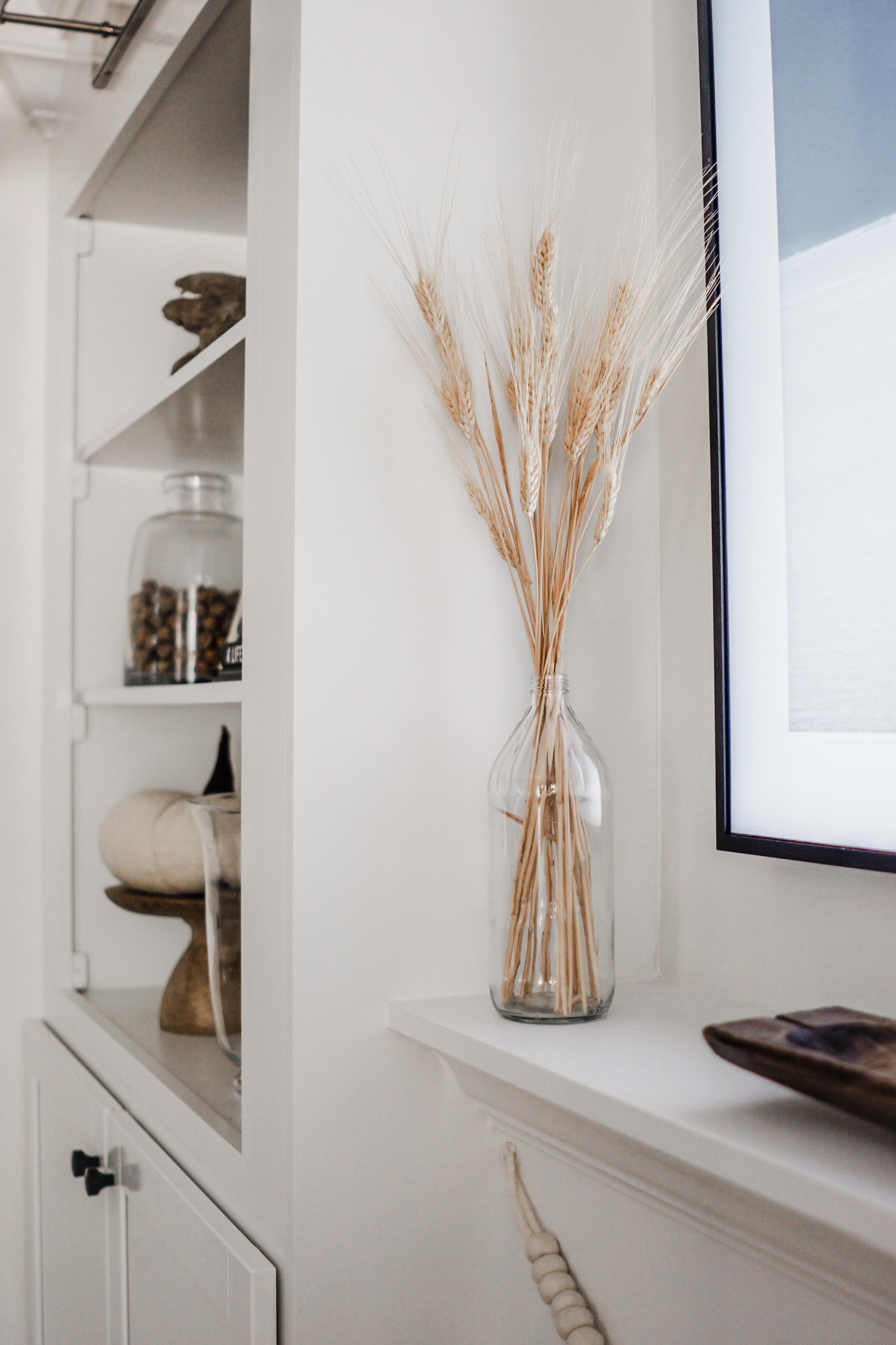 fall decor inspiration - Wheat in a glass vase // fall living room decor idea
