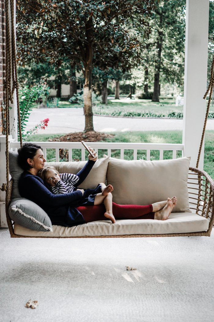outdoor woven swing on front porch