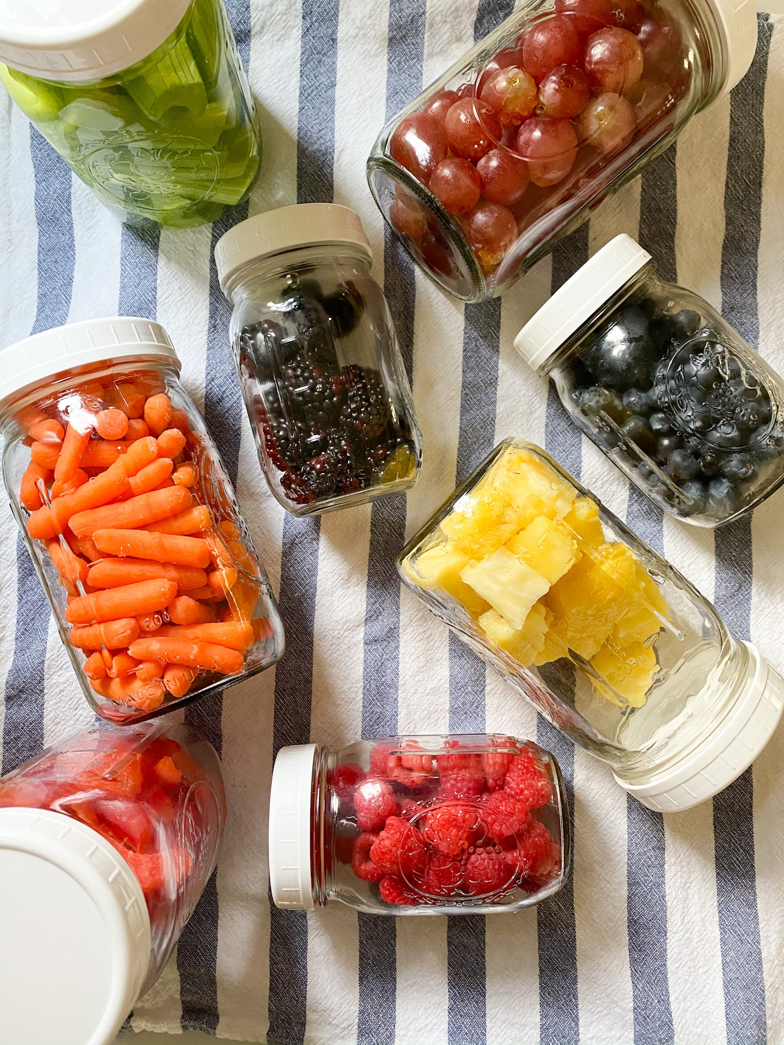 fresh fruits and veggies stored in mason jars
