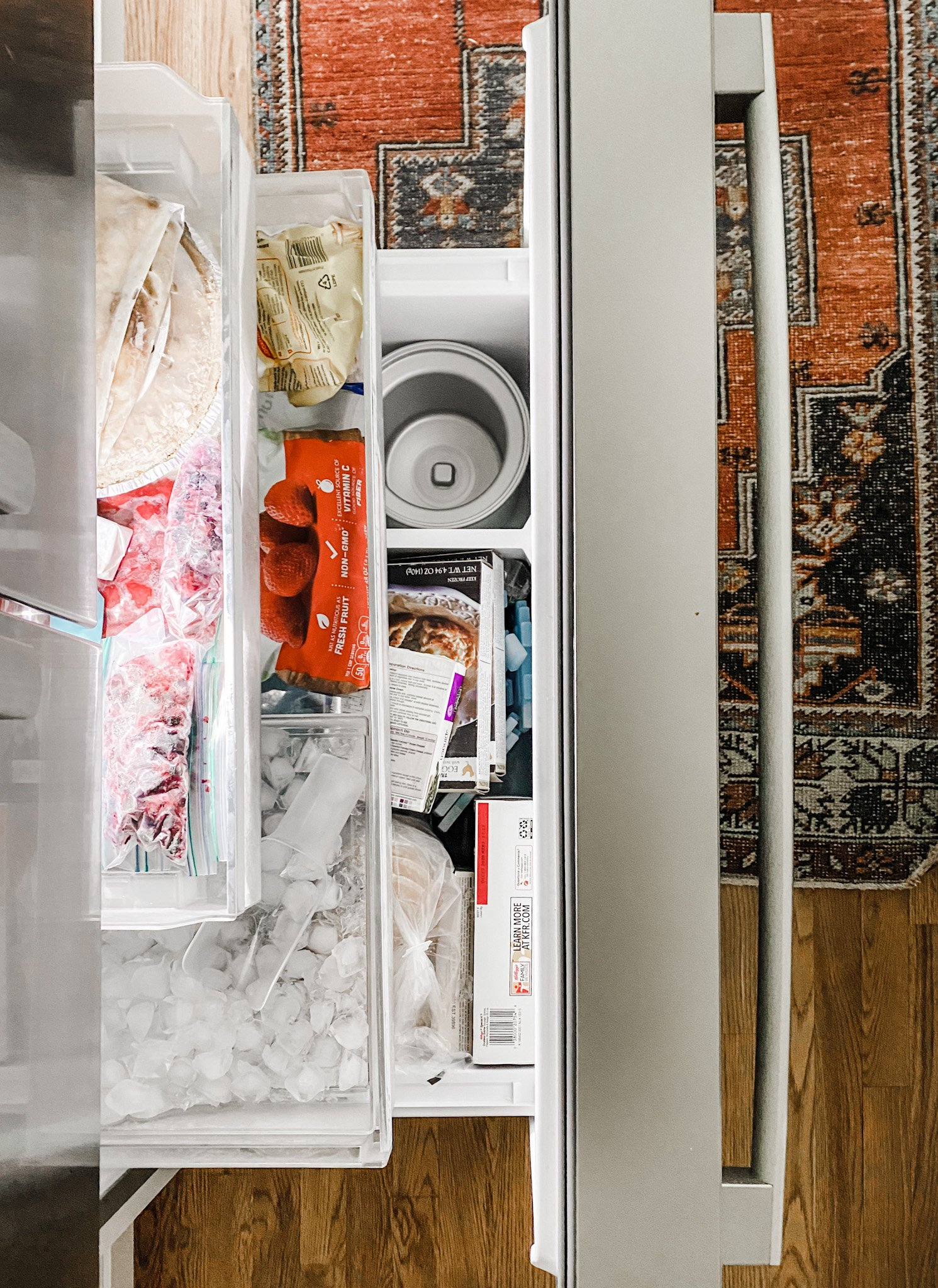 freezer drawer with 3 shelves and an ice maker