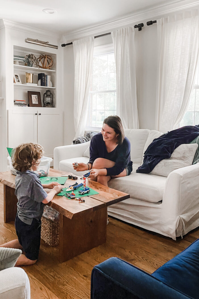 mom playing legos with child
